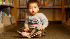 The Library Foundation - baby with book