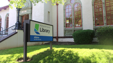 Photo of Albina Library building and sign