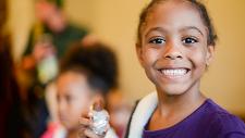 Little girl at book fair