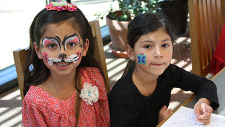 Girls at Dia de los Ninos celebration with faces painted