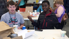 Two boys doing science in the makerspace