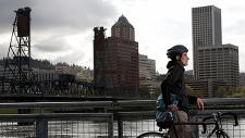 Portland cityscape and cyclist on bridge