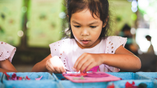Little girl working on an arts and craft project