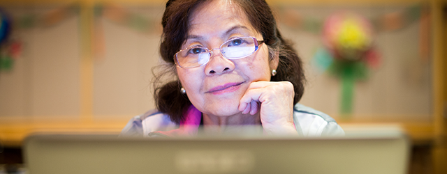 Woman using public computer at library