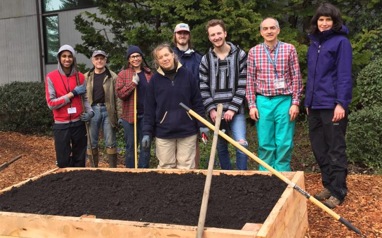 Staff working learning garden at Capitol Hill Library