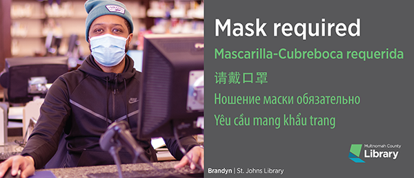 Library staff person wearing a mask, masks are required in libraries