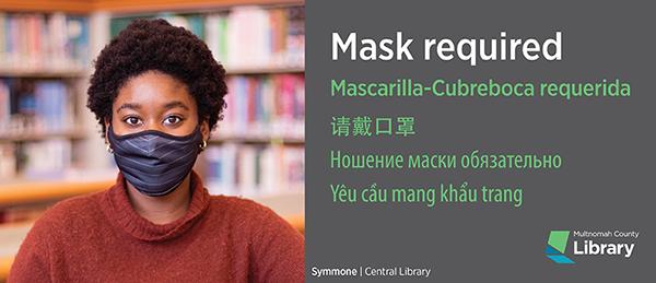 Hình nhân viên thư viện đeo khẩu trang, phải đeo khẩu trang trong thư viện