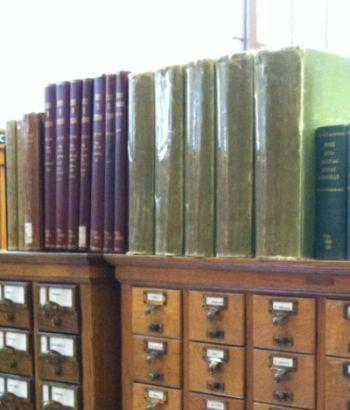 photograph of bound newspaper index volumes, at Central Library
