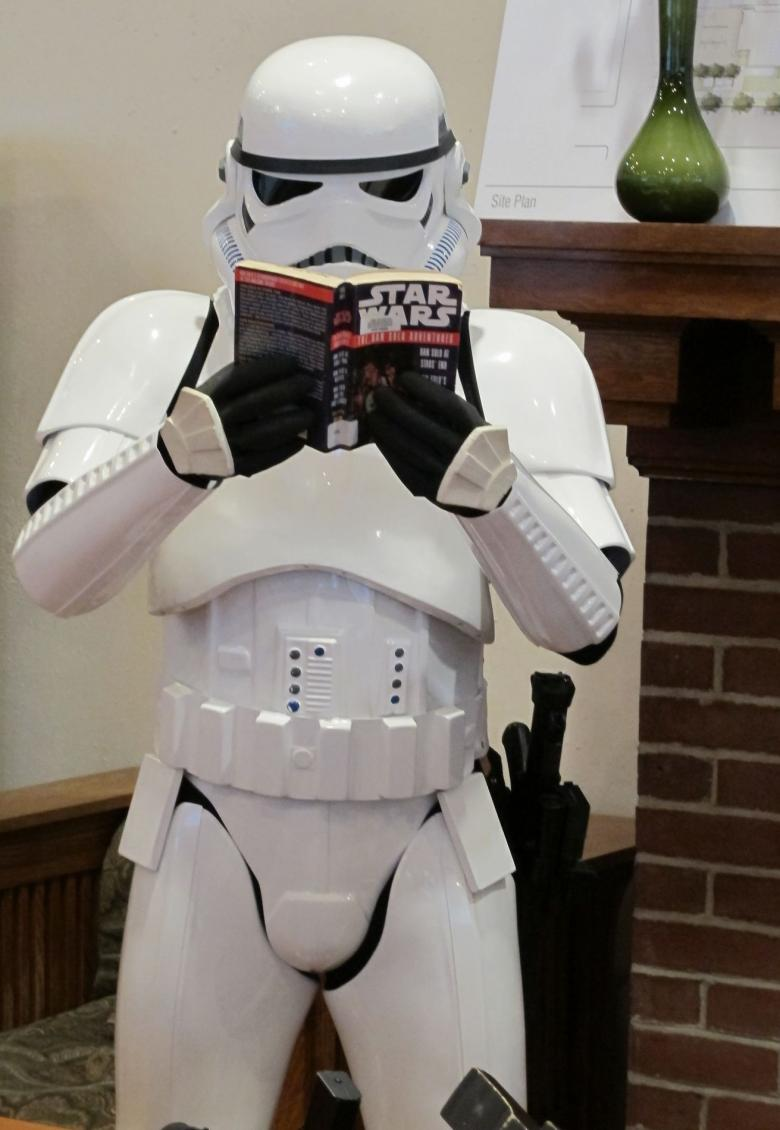 Photo of a stormtrooper reading a book.