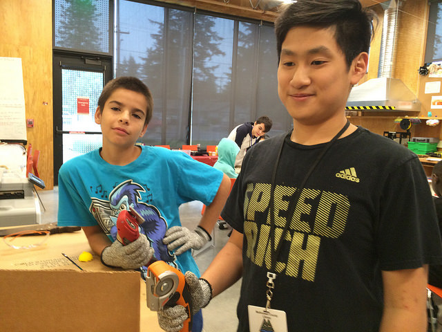 Makerspace teens with angle grinder