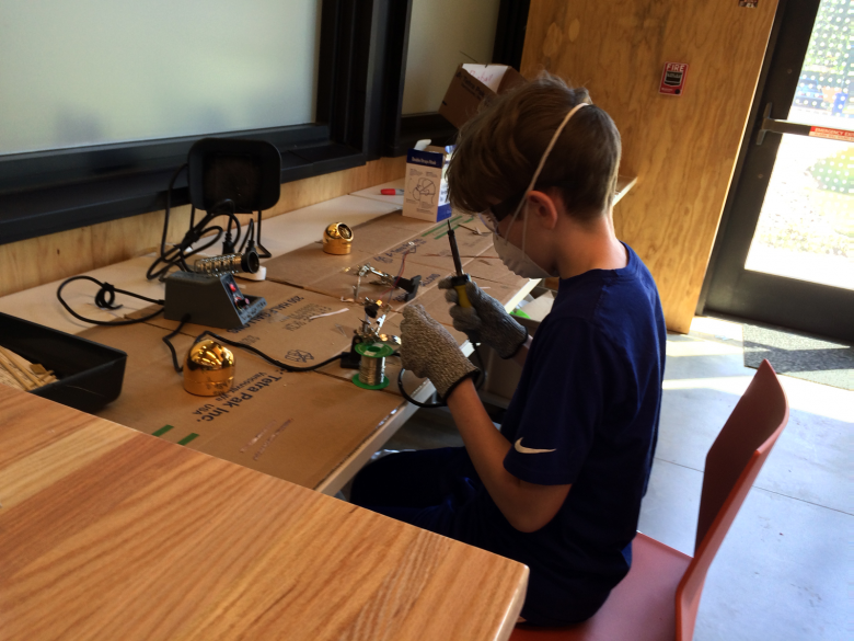 Makerspace teen soldering