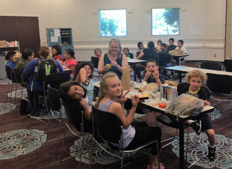 Kids enjoying the summer lunch program at Gresham Library