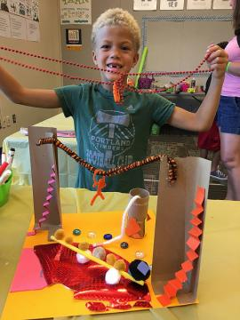 Child showing project made at library event