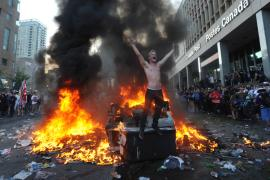 Image of rioter and fire