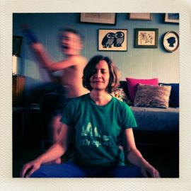 Photo of My Librarian Darcee meditating with running child in background