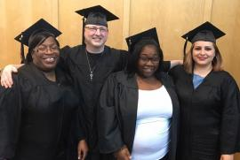 Graduates from the library's adult tutoring GED program