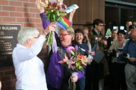 Deanna Geiger and Jean Nelson celebrate winning their case for marriage equality in Oregon [Photo by S. Mirk, via Flickr]