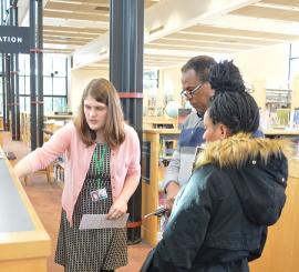 Library staff providing a tour of the library