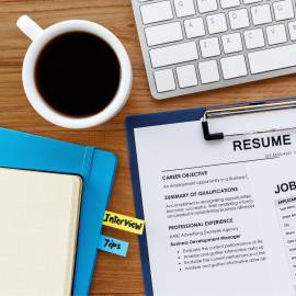 Image of resume, computer and coffee