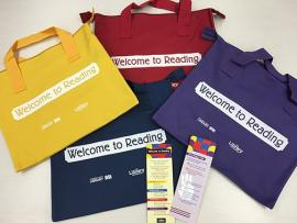 Four Welcome to Reading color coded kit bags and bookmarks
