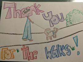 "Crayon drawing of a person walking a dog, with the words ""Thank you for the walks!"""