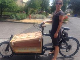 Street Librarian Diana Rempe shows off new bike library donated by Splendid Cycle