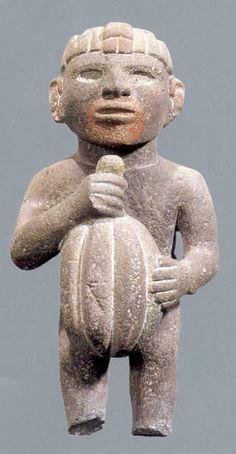 Man holding cacao fruit -  National Antropology and History Museum of Mexico