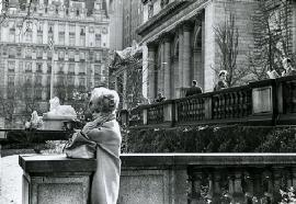 woman in front of nyc public library