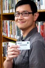 Patron holding a library card