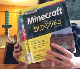 Photo of My Librarian Darcee reading Minecraft for Dummies