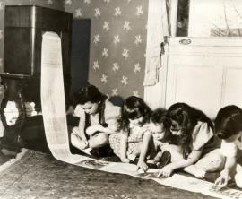 Children reading a wireless newspaper