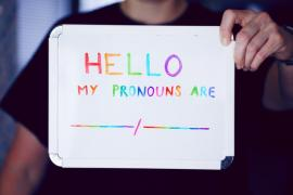 "sign that says, ""my pronouns are ____/ _____"""