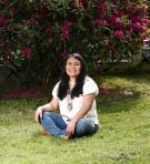 Latin woman sitting down on the grass